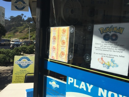 A sign outside of Kawika's Ocean Beach Deli advertises Pokemon Go related activities to passersby in San Francisco, on Monday, July 11, 2016. The Pokemon Go craze marks a turning point for augmented reality, technology that superimposes a digital facade on the real world. And that, in turn, has led to new weirdness, like property owners getting annoyed at legions of monster-hunters tramping nearby or store owners using the game to attract customers. (AP Photo/David Hamilton)